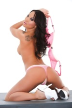 Asa Akira poses her killer curves in pink lingerie.